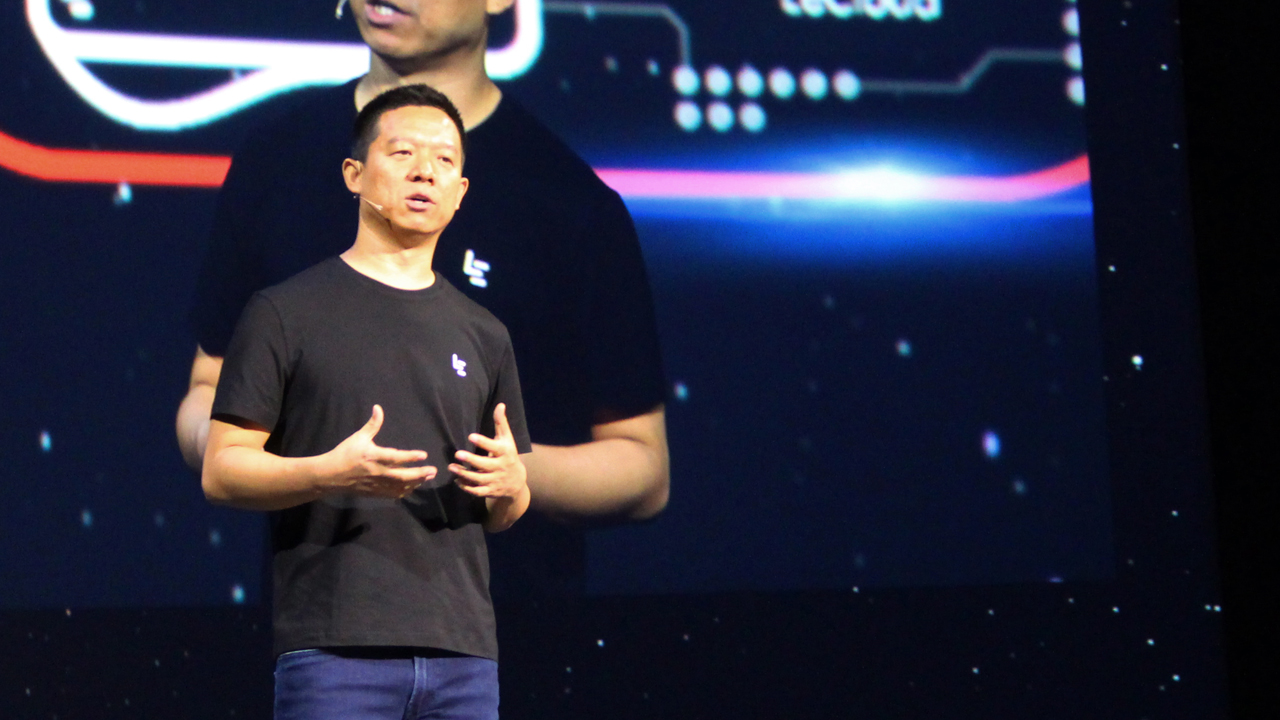 LeEco co-founder and chief executive Yueting Jia, at a press event in San Francisco, discusses the Chinese technology company's move into the US market. LeEco, referred to as a combination of Netflix, Apple, Amazon and Tesla, announced Wednesday it is taking on US tech titans on their home turf. / AFP PHOTO / Glenn CHAPMAN