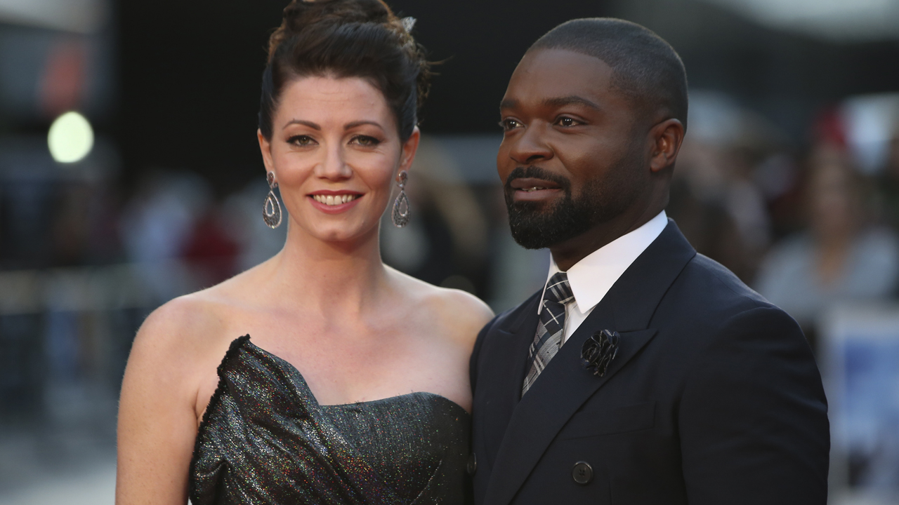"British actor and producer David Oyelowo (R) and his wife British-American actress Jessica Oyelowo (L) pose on the red carpet for the film ""A United Kingdom"" during the opening night gala event for the BFI London Film Festival in London on October 5, 2016. / AFP PHOTO / DANIEL LEAL-OLIVAS"