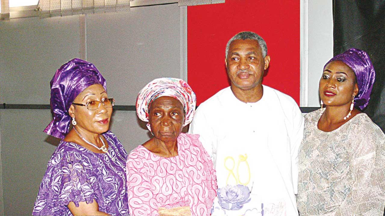 Alhaja Adebisi Ebiti (left); celebrant, Deaconess, Bolaji Makinde; her son, Mr. Kunle Makinde and daughter, Mrs. Ronke Ewegbemi