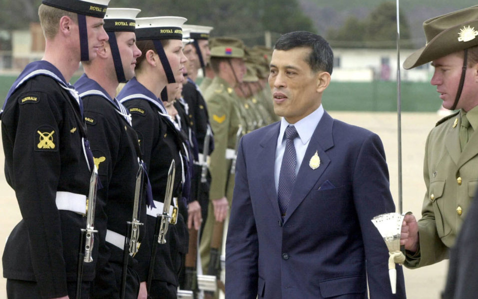 Crown Prince Maha Vajiralongkorn (C) of Thailand inspecting the guard of honour upon his arrival in Canberra. Crown Prince Maha Vajiralongkorn will succeed his father, Thailand's junta chief said on October 13, 2016, following the death of King Bhumibol Adulyadej after a long battle with ill health. / AFP PHOTO / NEWS LTD / JOHN FEDER / Austria OUT