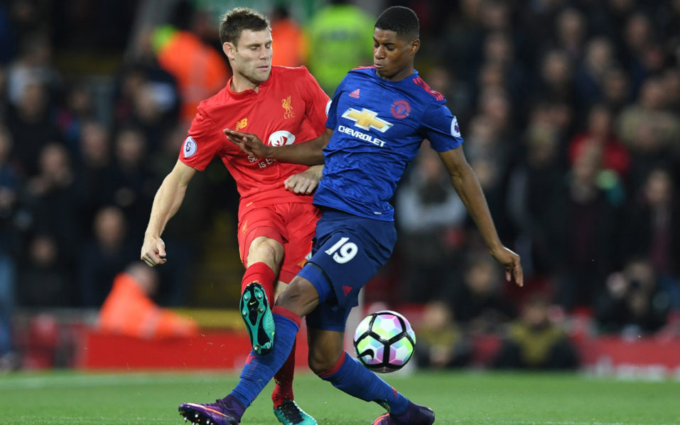 Manchester United's English striker Marcus Rashford (R) makes a rash tackle on Liverpool's English midfielder James Milner early in the English Premier League football match between Liverpool and Manchester United at Anfield in Liverpool, north west England on October 17, 2016. / AFP PHOTO / Paul ELLIS /