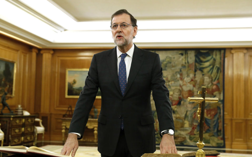 Spain's newly re-elected Prime Minister Mariano Rajoy swears an oath during a royal decree ceremony at the Zarzuela Palace in Madrid on October 31, 2016 after Rajoy won a confidence vote in parliament over the weekend. He is expected to name his new cabinet This week after which he will need to submit a budget to parliament for approval after a delay of several months -- a difficult task given that he commands the votes of just 137 of Spain's 350 lawmakers in the lower house.  / AFP PHOTO / POOL / Chema Moya