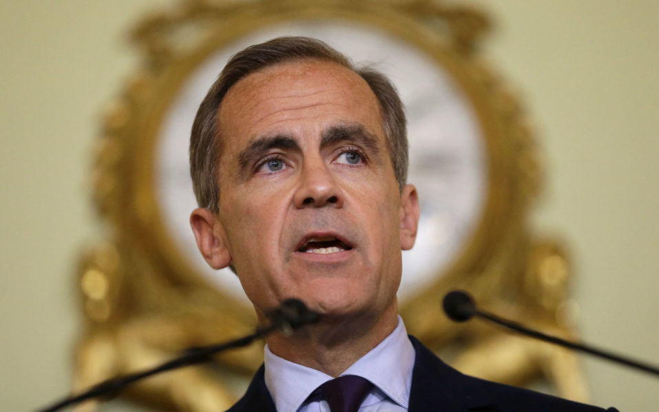 (FILES) This file photo taken on June 30, 2016 shows Governor of the Bank of England, Mark Carney giving a press conference at the Bank of England in the City of London, on June 30, 2016. Media speculation mounted on October 30, 2016 that the governor of the Bank of England, Mark Carney, is set to announce his departure amid tensions with Prime Minister Theresa May's new government. The Canadian is on a five-year contract that expires in 2018 but has an option to extend the job until 2021, a decision the central bank has said will be made public by the end of this year. / AFP PHOTO / POOL / Matt Dunham