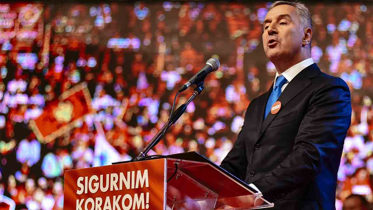 Montenegrin Prime Minister Milo Djukanovic speaks during an election rally in Podgorica on October 14, 2016. NATO membership will be a central issue in Montenegro's general election on October 16, 2016, with the vote marking the latest episode in a power struggle between Russia and the West in the Balkans. / AFP PHOTO / SAVO PRELEVIC