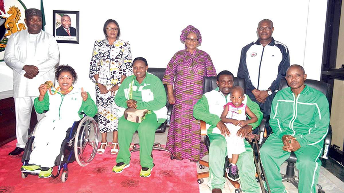 Governor Ifeanyi Ugwuanyi of Enugu State, his deputy, Mrs. Cecilia Ezeilo, State Commissioner for Gender Affairs and Social Development, Peace Nnaji, her counterpart in the Ministry of Youth and Sports, Mr. Charles Ndukwe, Rio Paralympics gold medalist, Mrs. Lucy Ejike (sitting), her husband, and the coaching crew when the governor honoured the gold medalist at Government House, Enugu… recently.