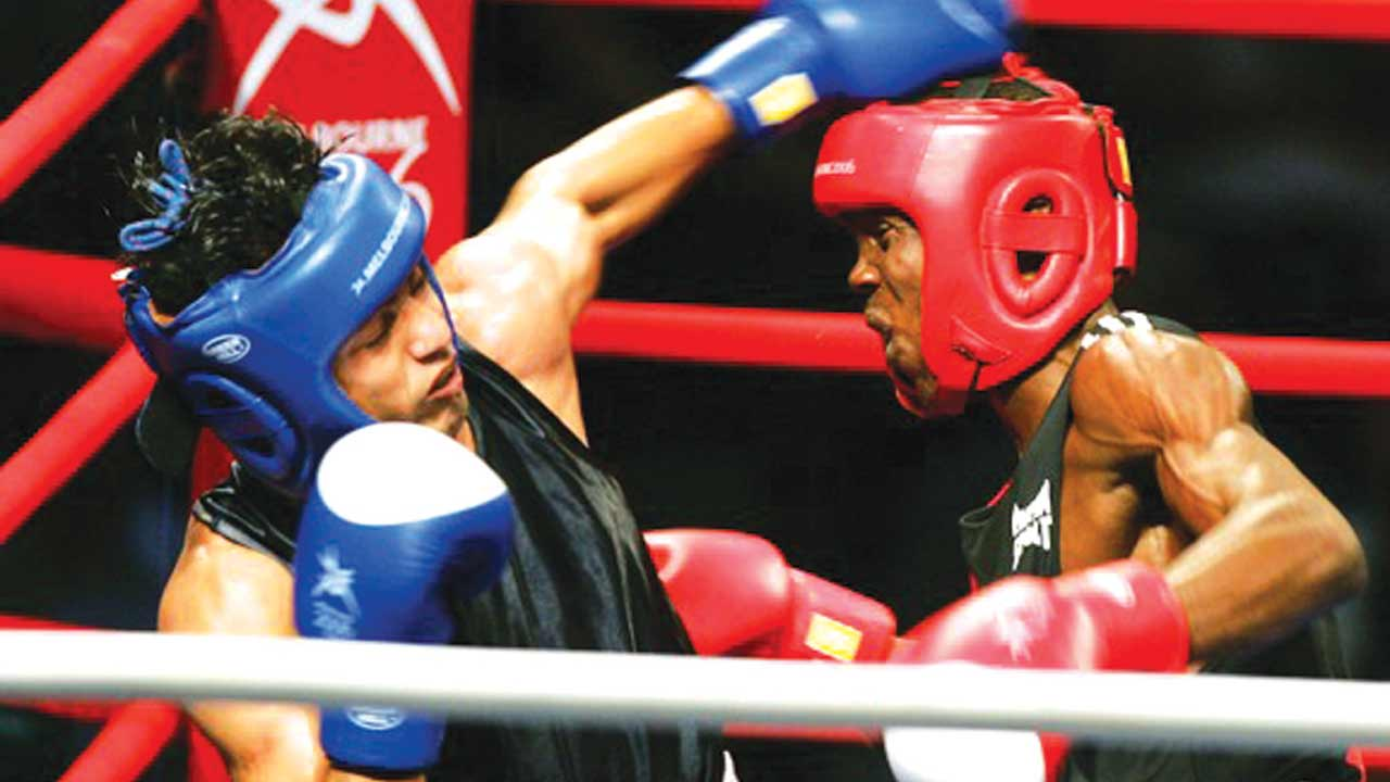 Nestor Bolum of Nigeria (right) exchanging punches with Akhil Kumar of India in the men's Bantamweight 54 kg semifinal bout at Melbourne Exhibition Centre during 2006 Commonwealth Games.