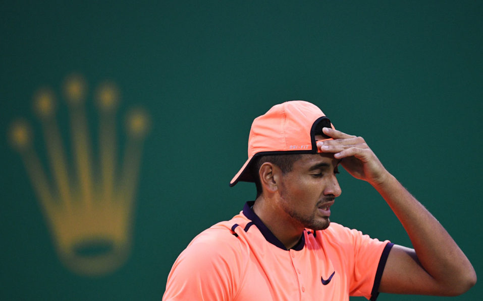 Nick Kyrgios of Australia reacting to his serve against Mischa Zverev of Germany during their men's singles match at the Shanghai Masters tennis tournament. The latest tantrum by Kyrgios has attracted more than a fine and condemnation as sports stars and experts wonder if he needs help to overcome his demons. Kyrgios was slapped with a 16,500 USD penalty for his meltdown at the recent Shanghai Masters in October, where he tanked points, swore and argued with fans before being booed off court. / AFP PHOTO / JOHANNES EISELE / TO GO WITH Tennis ATP CHN Shanghai Kyrgios, FOCUS BY TALEK HARRIS