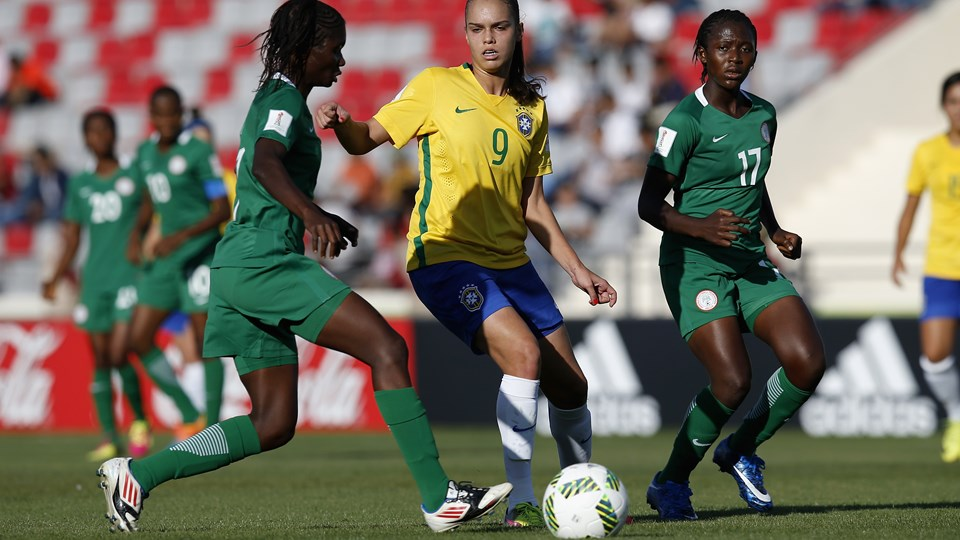 Folashade Ijamilusi (R) of Nigeria challenge Ana Vitoria (C) of Brazil during the FIFA U-17 Women's World Cup Group C match between Nigeria and Brazil at King Abdullah II International Stadium on October 1, 2016 in Amman, Jordan. (Photo by Boris Streubel - FIFA/FIFA via Getty Images)