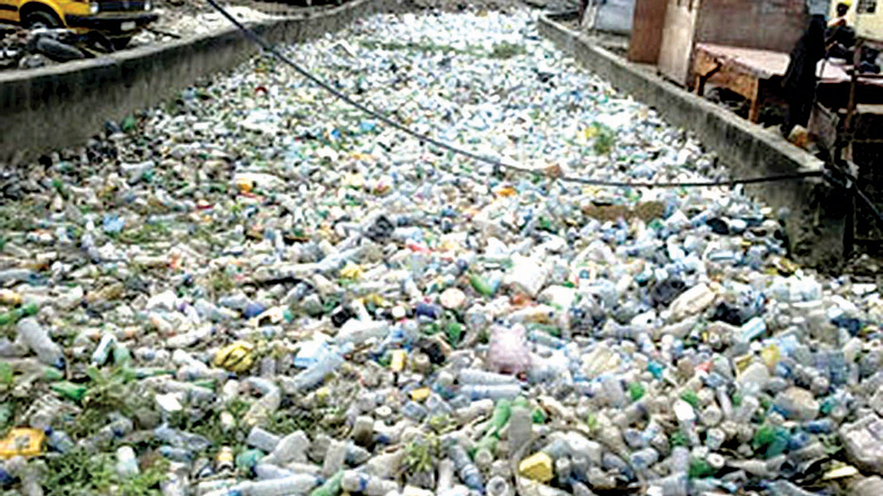 Used pet bottles blocking a drainage
