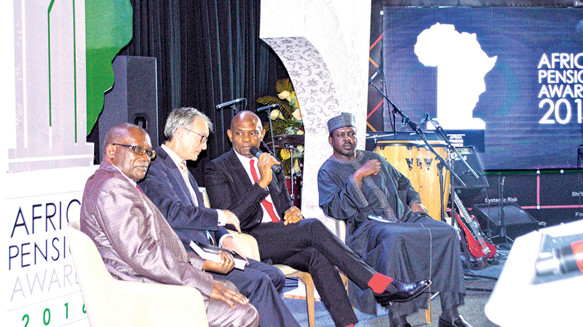 Minister of Public Service, Uganda, Wilson Muruli Mukasa (left);  Executive Director, Royal Africa Society, Richard Dowden; Chairman UBA Plc and Founder, Tony Elumelu Foundation, Tony O. Elumelu;  and former Nigeria Minister of Works, Sanusi Daggash, at the World Pension Summit 'Africa Special' And Africa Pension Awards held in Abuja.