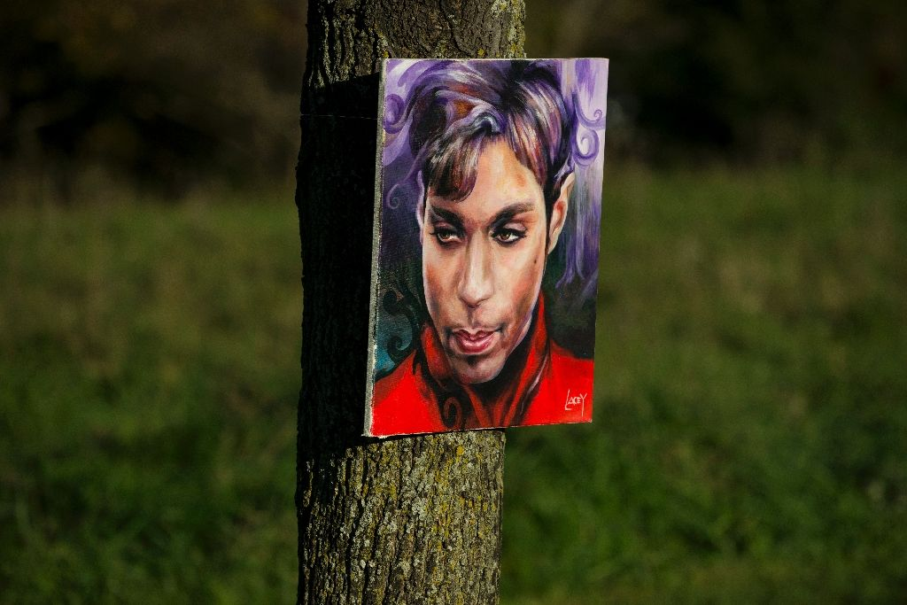 A portrait of Prince by artist Daniel Lacey hangs outside Paisley Park in Chanhassen, Minnesota on October 6, 2016. PHOTO: AFP Photo/Stephen Maturen
