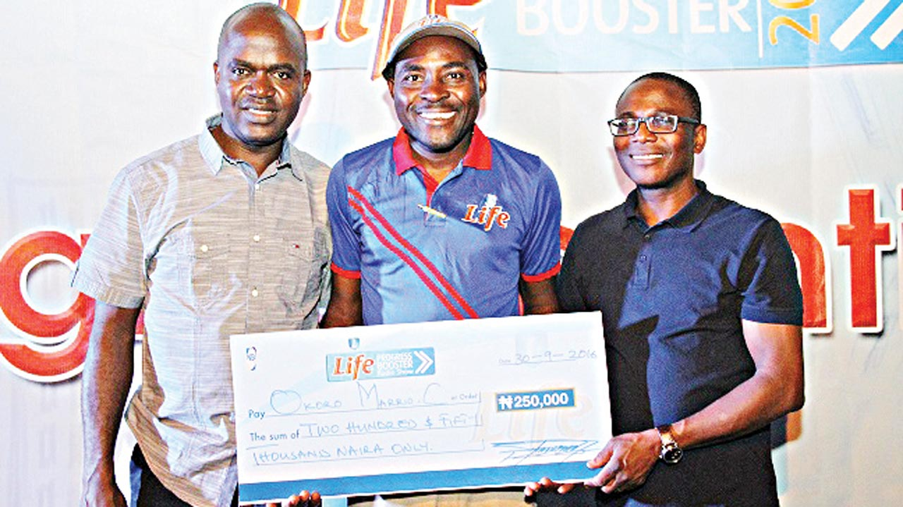 Portfolio Manager Mainstream Lager and Stout brands, NB Plc, Emmanuel Agu (left); winner Progress Booster, Okoro Mario, and Rotimi Odukudu Head, Supply Chain Academy, NB Plc