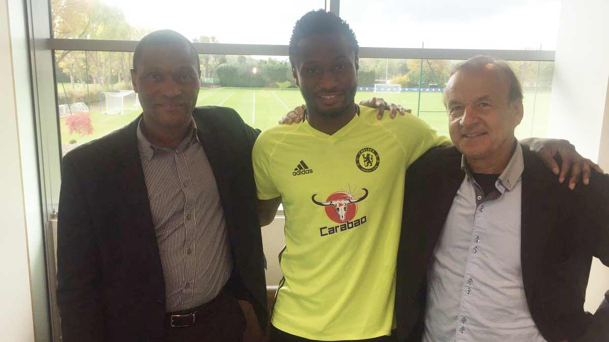 Coach Gernot Rohr (right), with Super Eagles' Captain, John Obi Mikel (middle) and Chelsea Director, Mike Emenalo, when the Nigerian manager visited Chelsea's training ground…yesterday. PHOTO: NFF
