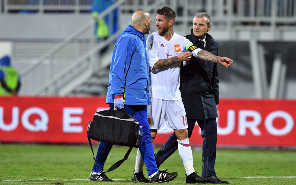 Spain's Sergio Ramos leaves the pitch after injury during the FIFA World Cup 2018 qualification football match Albania vs Spain at the Loro-Borici stadium in Shkoder, on October 9, 2016. / AFP PHOTO / Andrej ISAKOVIC