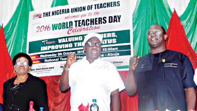 Representative of the Minister of Education, Mrs Chetachi Azubuike; National President, Nigeria Union of Teachers (NUT), Comrade Michael Olukoya and the National President of the Nigeria Labour Congress (NLC), Comrade Ayuba Wabba, during the celebration of the World Teachers' Day, in Abuja, on Wednesday. PHOTO: NAN