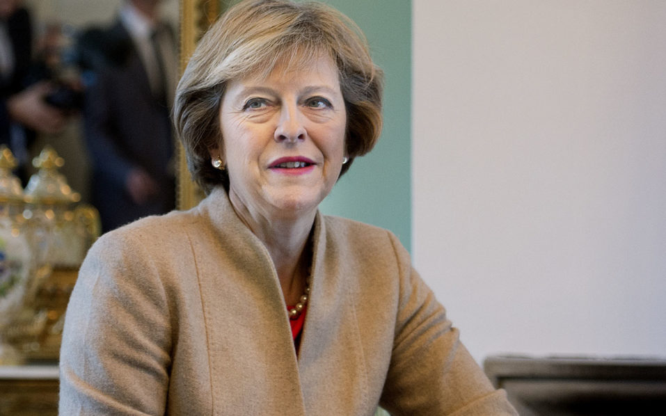 UK Prime Minister Theresa May  / AFP PHOTO / Scanpix Denmark / Liselotte Sabroe / Denmark OUT