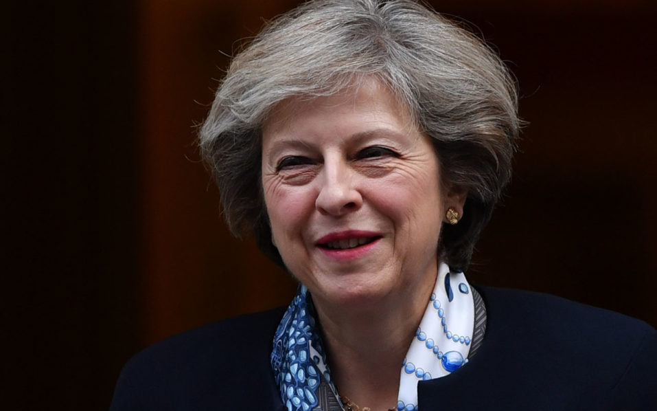 British Prime Minister Theresa May leaves 10 Downing street in London on October 12, 2016. British Prime Minister Theresa May signalled ahead of a House of Commons debate today that she would let parliament scrutinise her plan for Brexit before she begins the formal process to exit the EU. / AFP PHOTO / BEN STANSALL
