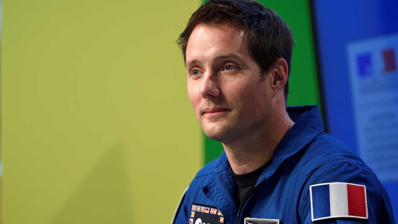 "This file photo taken on October 7, 2016 shows France's astronaut Thomas Pesquet looking on during the ""Fete de la Science"" (Science Festival) at the Cite des Sciences. Pesquet, who will leave by mid-November for a six-month mission called 'Proxima' to the International Space Station (ISS) said on October 26, 2016 he will 'take this incredible chance' to show people 'how interesting it is' from space.  Eric FEFERBERG / AFP"