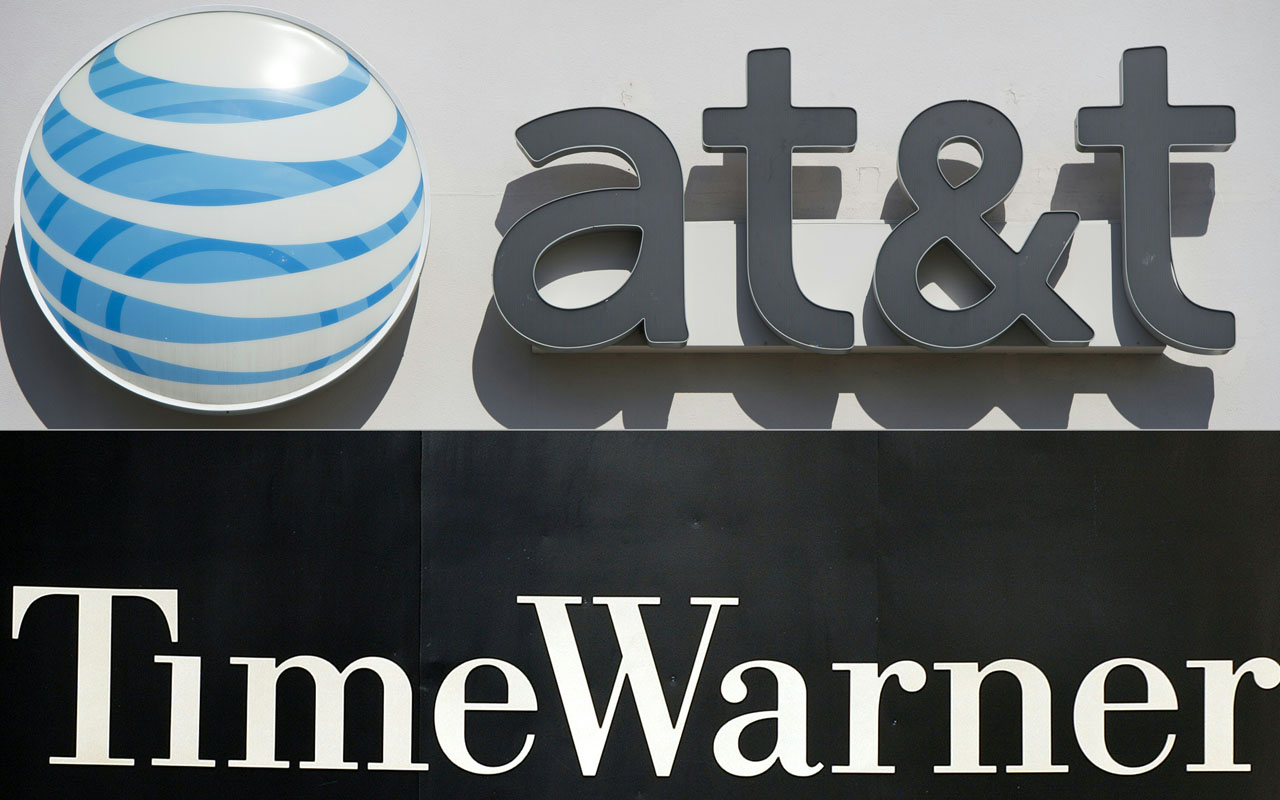 (FILES) This file combination of pictures created on October 21, 2016 shows an AT&T cellphone store (TOP) in Springfield, Virginia, on October 23, 2014, and the Time Warner company logo on the front of the headquarters building, 24 November, 2003 in New York. An AT&T-Time Warner mega-deal could create a new kind of media-tech firm in an age where consumers get content Netflix-style, when they want it on any device. Or it could be a remake of another huge merger 16 years ago that sought to unite the media-entertainment giant with another tech sector leader but ended in failure.The deal unveiled October 22, 2016 aims to make AT&T a powerhouse positioned for a sector facing major technology changes. / AFP PHOTO / SAUL LOEB AND STAN HONDA