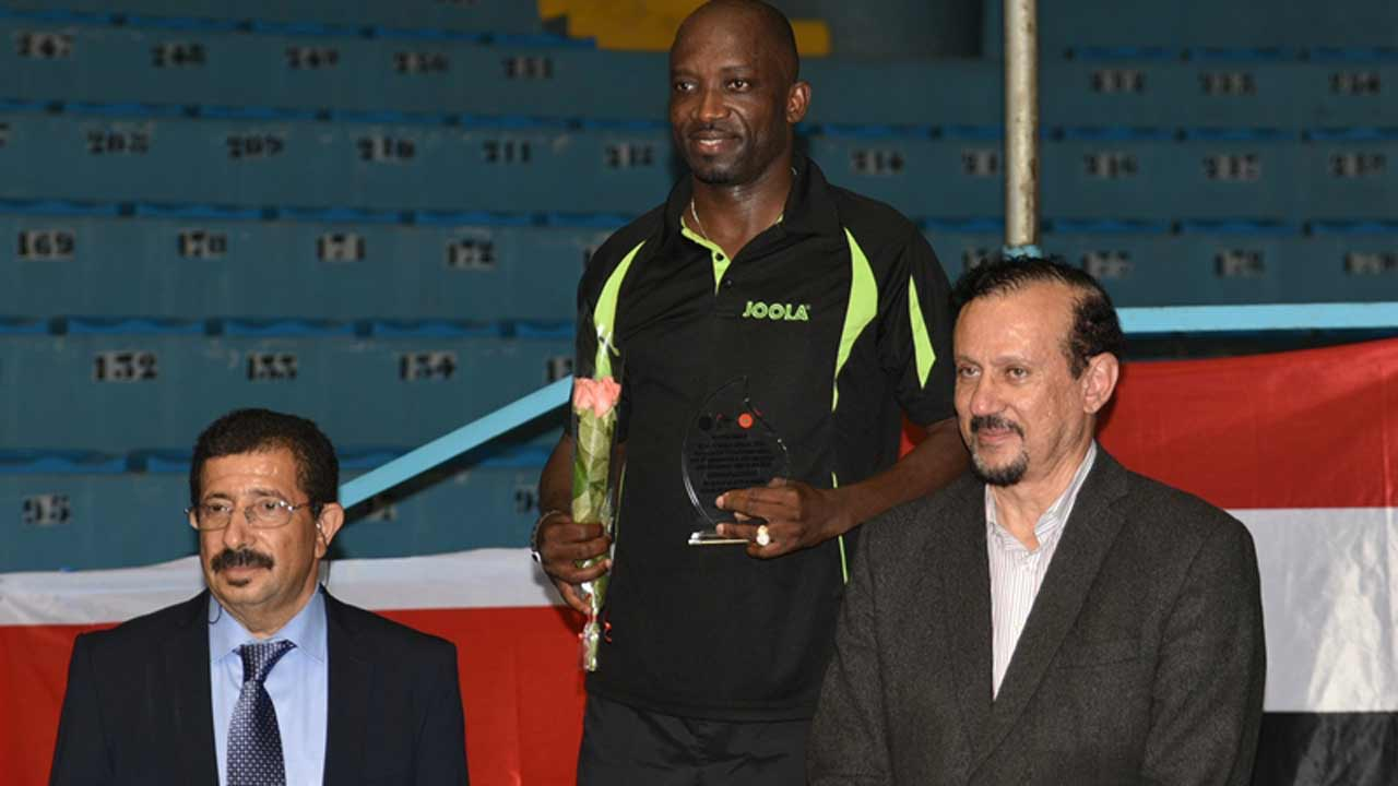 Segun Toriola (middle), flanked by ITTF-Africa officials, after receiving his award from the continent's table tennis ruling body.