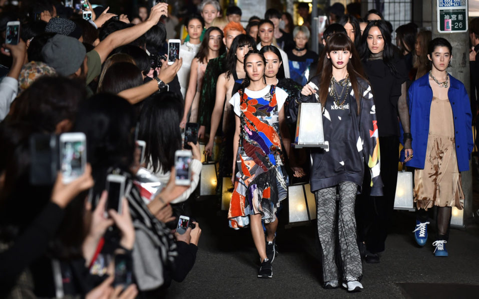 Models display creations by designer Christelle Kocher during the KOCHE AW16 and SS17 mix collection show presented by H BEAUTYYOUTH at Amazon Fashion Week in Tokyo on October 19, 2016. / AFP PHOTO / KAZUHIRO NOGI