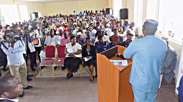 A member of the Lagos State House of Assembly addressing his constituents at one of the townhall centres