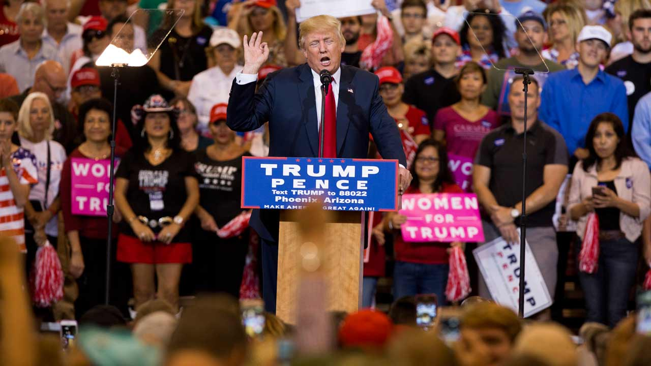 Republican Presidential nominee Donald Trump speaks during a rally at the Convention center in Phoenix, Arizona on October 29, 2016. America's top cop FBI Director James Comey found himself center stage Saturday as his renewed probe of Hillary Clinton's emails set a bitter tone for the final ten-day stretch of the campaign. Both Clinton and her Republican rival Donald Trump piled pressure on Comey to put his cards on the table and end speculation about the investigation before America goes to the polls on November 8. Caitlin O'HARA / AFP