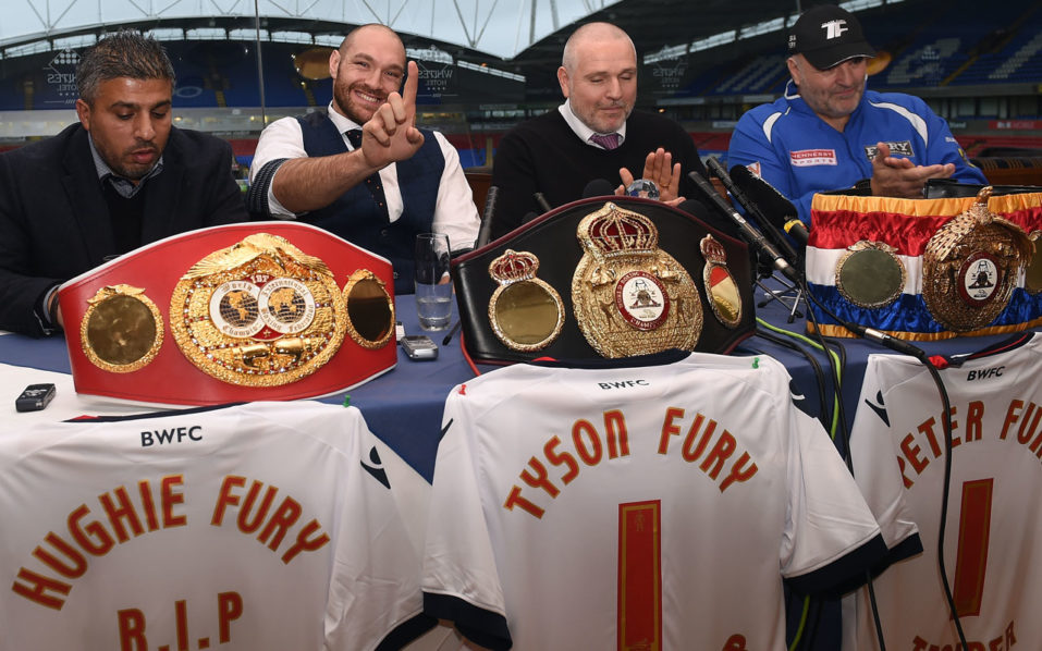 "(FILES) This file photo taken on November 30, 2015 shows (L-R) Asif Vali, Britain's world heavyweight champion Tyson Fury, trainer and uncle Peter Fury and father John Fury take part in a press conference in Bolton, north west England. Tyson Fury has given up his WBO and WBA world heavyweight titles ""with immediate effect"" to concentrate on his ""medical treatment and recovery"", said a statement released on October 12, 2016, by his promoters Hennessy Sports. The British boxer has admitted taking cocaine to deal with depression and was set to be stripped of his titles after cancelling two planned rematches this year against Ukrainian former champion Wladimir Klitschko. / AFP PHOTO / PAUL ELLIS"