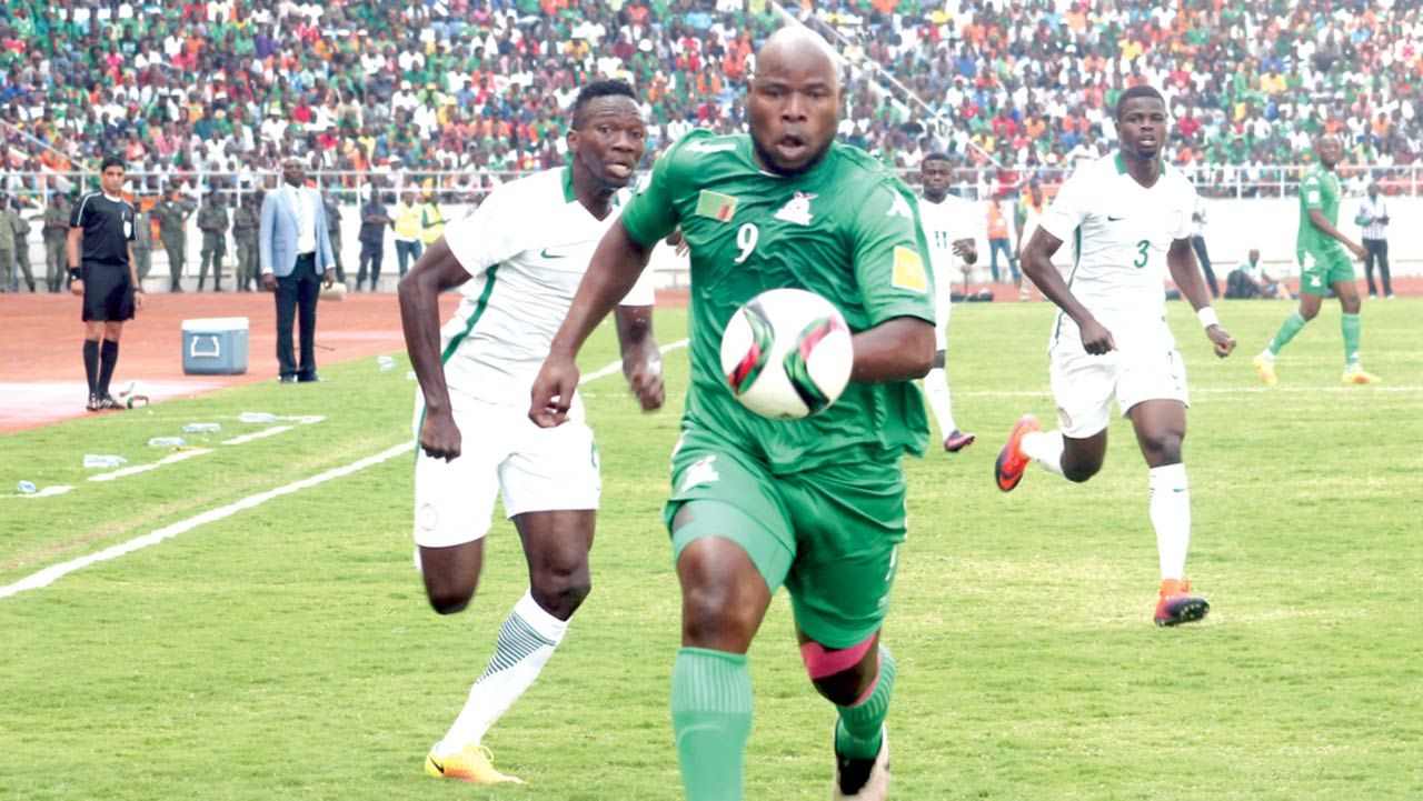 Zambia's Collins Mbesuma runs with the ball during the FIFA World Cup qualifier against Nigeria at the Levy Mwanawasa Satdium in Ndola…at the weekend.