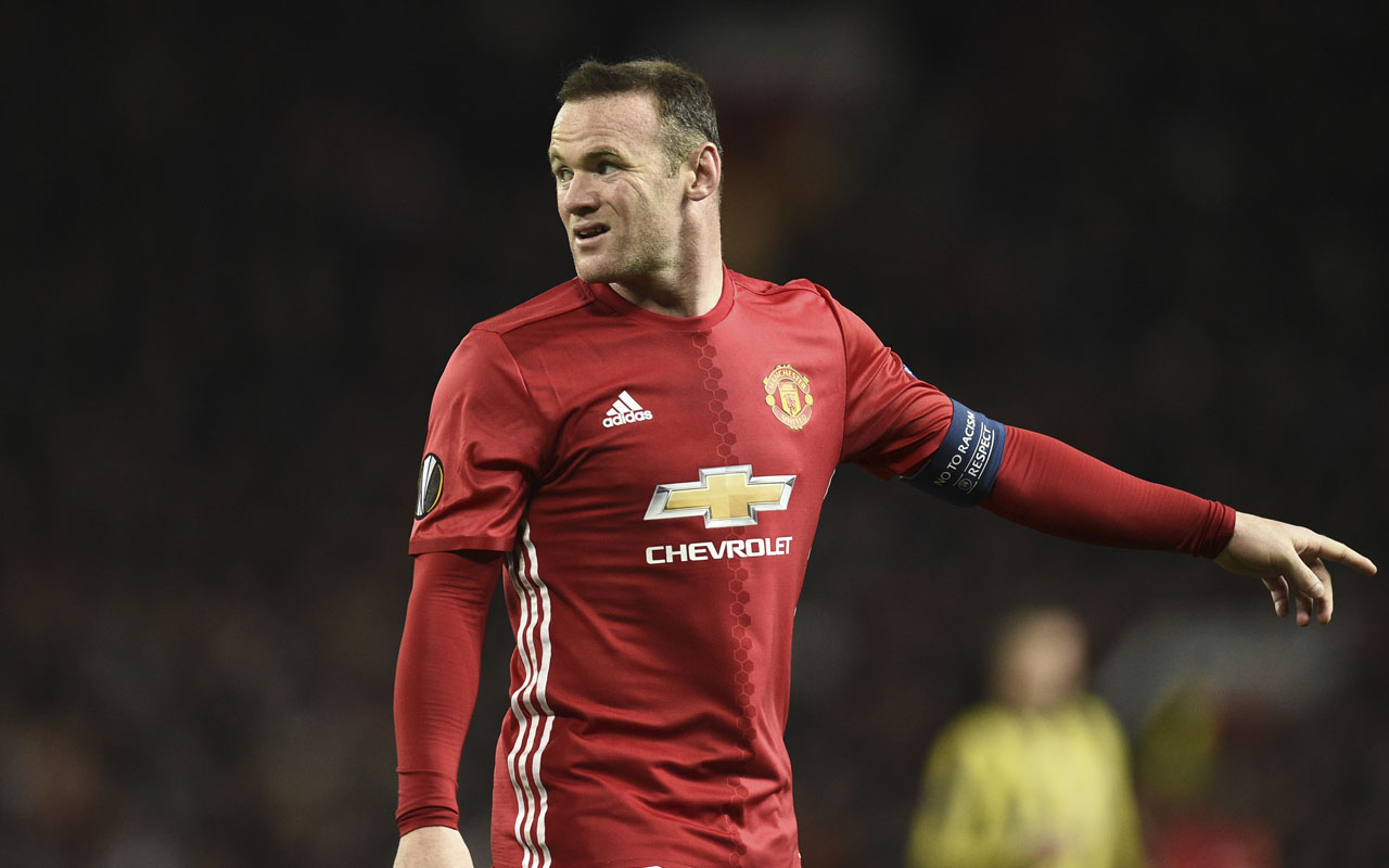 Manchester United's English striker Wayne Rooney / AFP PHOTO / OLI SCARFF