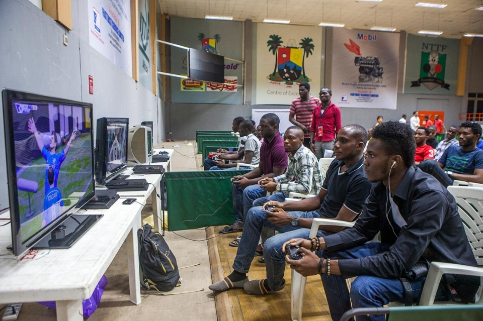 Attendants play various video games at the inaugural WAGE 14, Dec. 20, 2014.