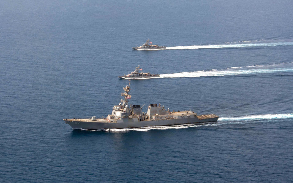 A file image released by the US Navy shows a guided-missile destroyer USS Mason (DDG 87) conducting formation exercises with the Cyclone-class patrol crafts USS Tempest (PC 2) and USS Squall (PC 7) on a September 10, 2016. Two missiles fired from rebel-held territory in Yemen fell short of a US warship patrolling the Red Sea off the coast of the war-torn country, the US navy said on October 10, 2016.  / AFP PHOTO / Navy Visual News Service (NVNS) / Mass Communications Specialist 3