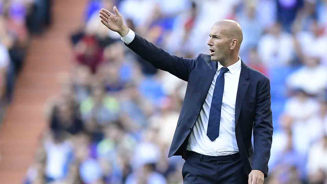 Real Madrid's French coach Zinedine Zidane gestures during the Spanish league football match Real Madrid CF vs SD Eibar at the Santiago Bernabeu stadium in Madrid on October 2, 2016. / AFP PHOTO / JAVIER SORIANO