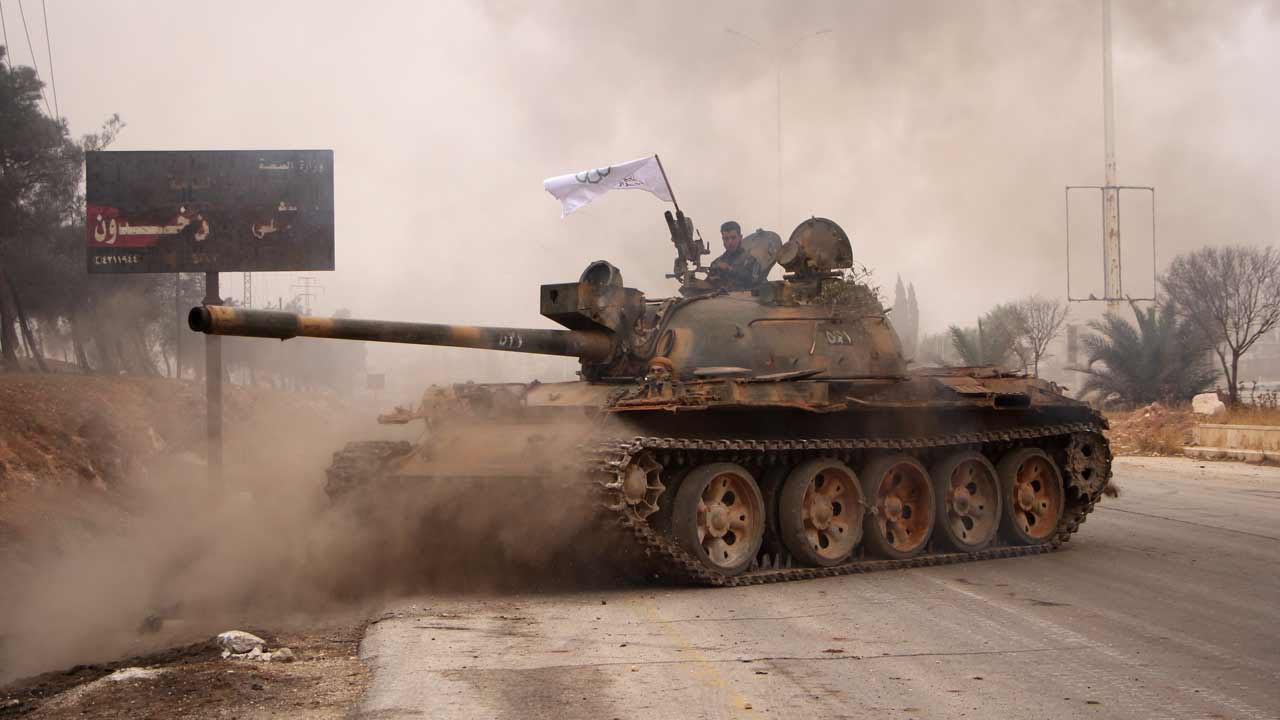 Rebel fighters from the Jaish al-Fatah (or Army of Conquest) brigades manoeuver a T-55 tank as they take part in a major assault on Syrian government forces West of Aleppo city on October 28, 2016. Syrian opposition fighters launched a major assault on government forces to break a months-long siege of rebel-held neighbourhoods of the battered city of Aleppo. Rebel groups including the powerful Ahrar al-Sham faction and former Al-Qaeda affiliate Fateh al-Sham Front fired waves of rockets into government-held western Aleppo, killing at least 15 civilians, a monitor said. The rebels also targeted government positions east of Aleppo city and in the coastal province of Latakia. Omar haj kadour / AFP