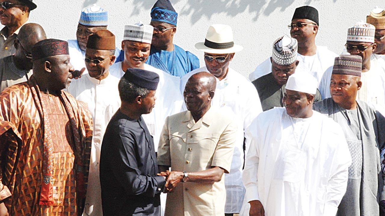 Imo State Governor Rochas Okorocha (left); Vice President Yemi Osinbajo; Okorcha's counterparts in other states, Adams Oshiomhole (Edo); Aminu Tambuwa (Sokoto); Alhaji Kashim Shettima (Borno)and other colleagues with outgoing Governor Oshiomhole after the National Economic Council meeting at the State House Abuja…yesterday PHOTO: PHILIP OJISUA