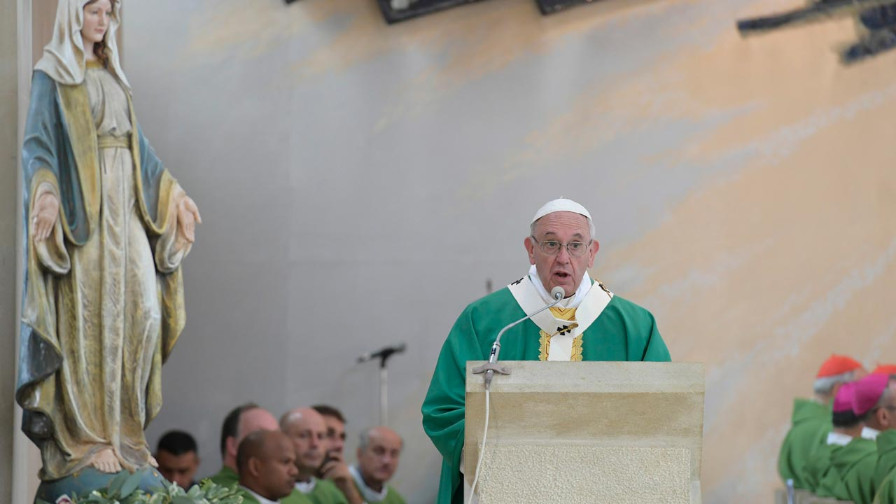 In this handout picture released by the Vatican Press Office Pope Francis celebrates a mass at the Immaculate church in Baku, Azerbaijan, on October 2, 2016. Azerbaijan, the second-largest Shiite Muslim nation after Iran, has a tiny Catholic population - fewer than 300 Azeris are Catholics. Several thousand foreigners make up the rest of the Catholic community, and Azeri Jews, Zoroastrians and other minorities round out Azerbaijan's religious mix. PHOTO: HO / OSSERVATORE ROMANO / AFP