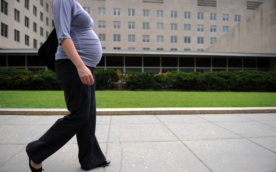 a pregnant woman walking outside the State Department in Washington, DC.   Doctors have long warned women that getting pregnant later in life can raise the risk of stroke, but a study October 24, 2016 suggested that actually, only young women face this increasing risk. The findings in the Journal of the American Medical Association (JAMA) Neurology compared stroke rates among pregnant and non-pregnant women of different age groups.  / AFP PHOTO / Timothy SLOAN