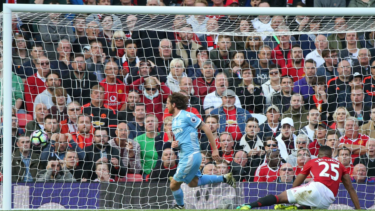 Stoke City's Welsh midfielder Joe Allen celebrates after he scores Stoke's equalizer during the English Premier League football match between Manchester United and Stoke City at Old Trafford in Manchester, north west England, on October 2, 2016. The game ended 1-1. PHOTO: Scott Heppell / AFP