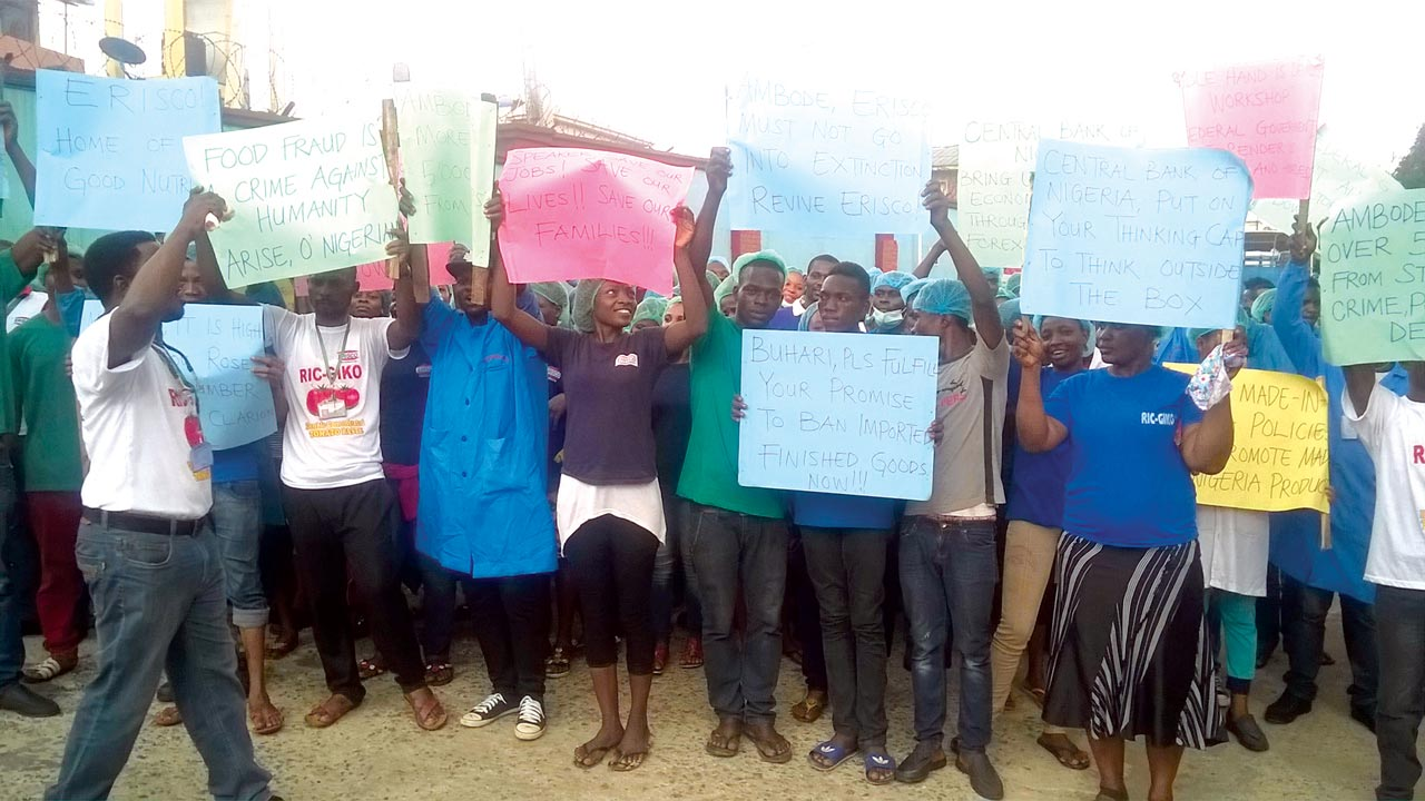 Cross section of Erisco Foods Limited workers protesting against the planned suspension of its multi-million Naira tomato paste processing plant in Lagos on Wednesday
