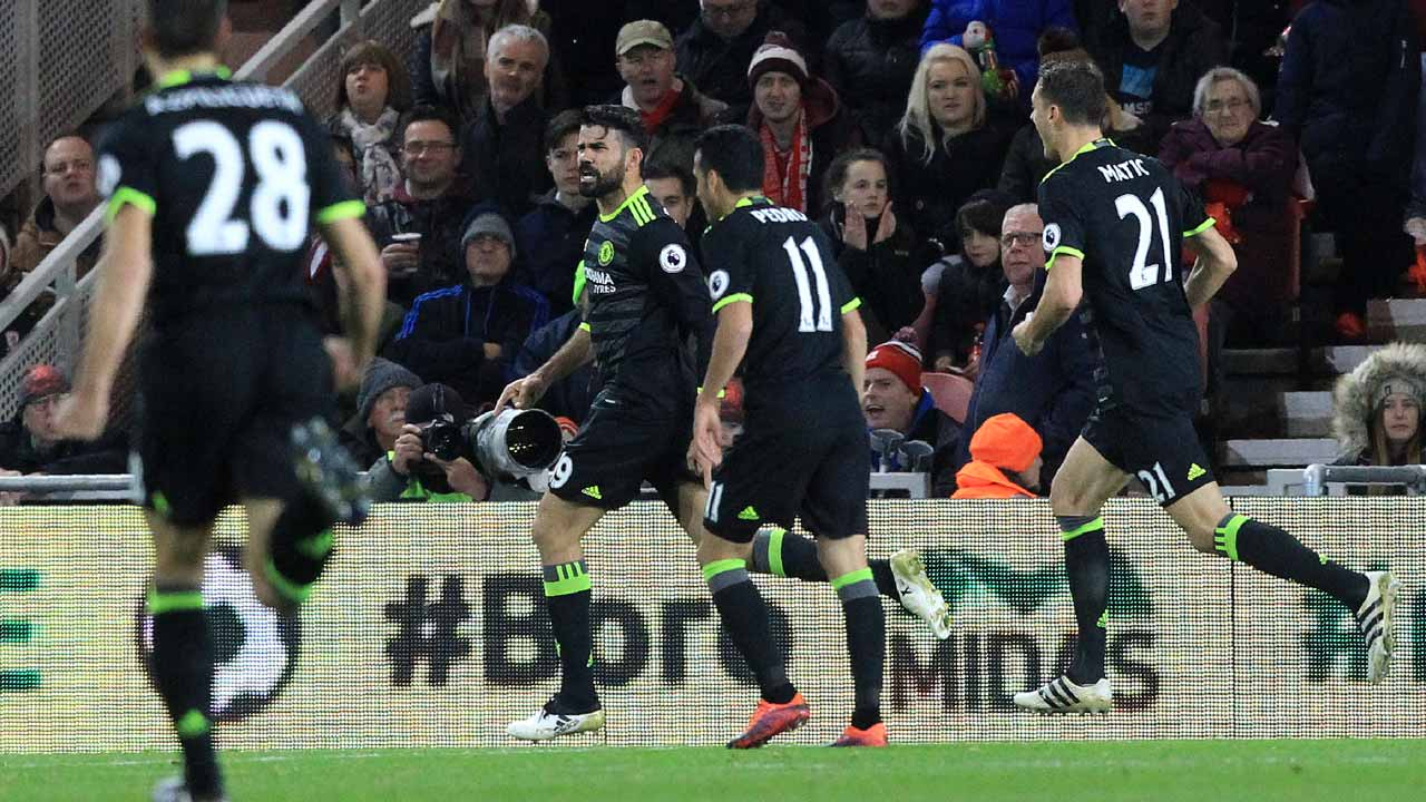 Chelsea's Brazilian-born Spanish striker Diego Costa celebrates scoring his team's first goal during the English Premier League football match between Middlesbrough and Cheslea at Riverside Stadium in Middlesbrough, northeast England on November 20, 2016. Lindsey PARNABY / AFP