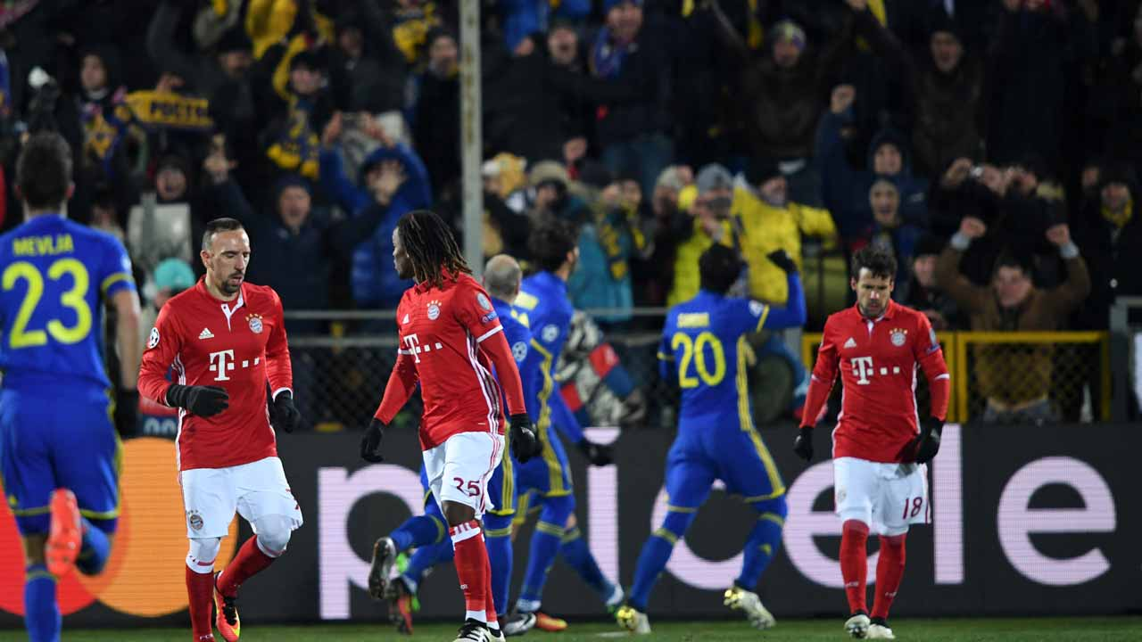 Bayern Munich's players react after Rostov's forward Dmitri Poloz scored his team's second goal from a penalty kick during the UEFA Champions League football match between FC Rostov and FC Bayern Munich at Rostov-on-Don's Olimp 2 stadium on November 23, 2016. Kirill KUDRYAVTSEV / AFP