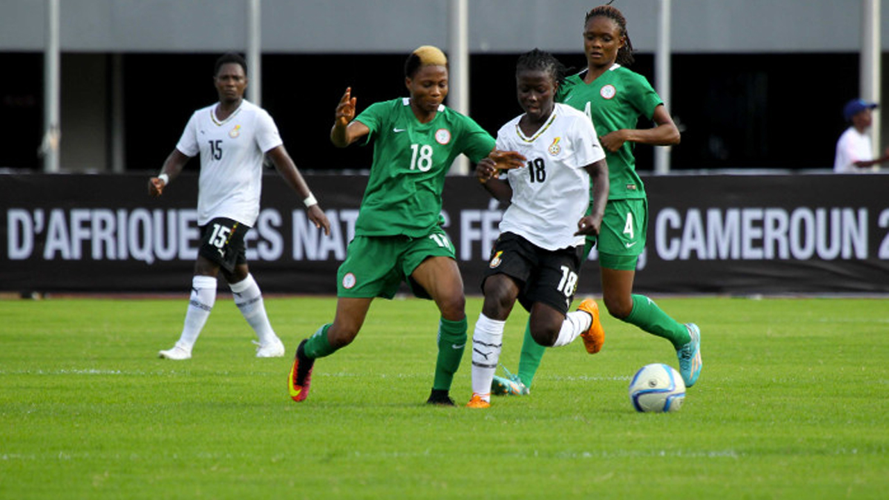 Super Falcons' Halimatu Ayinde (left) takes on Ghana's Elizabeth Addo during their Group B game at the on-going Cameroun 2016 African Women Nations Cup…yesterday. PHOTO: CAF.