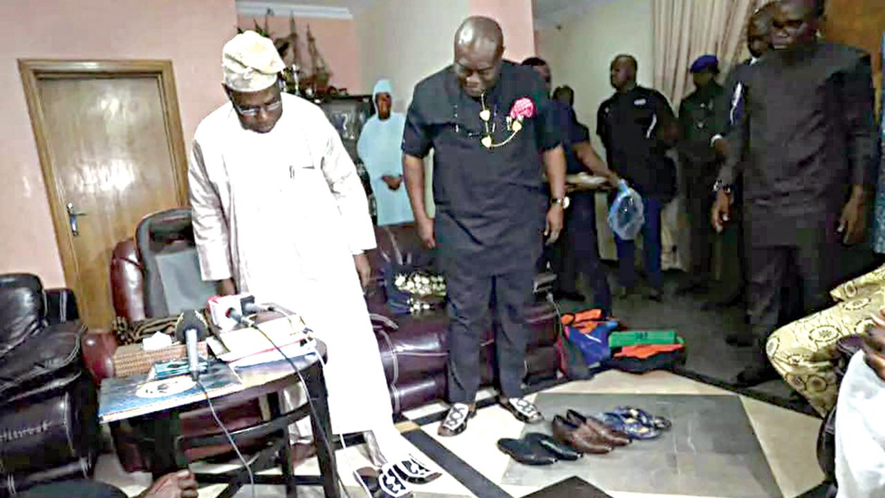 Former president Olusegun Obasanjo receives made in Aba shoes from Gov. Ikpeazu of Abia State.