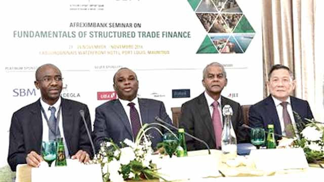 Chief Economist, Africa Export-Import Bank (Afreximbank), Dr. Hippolyte Fofack (left); President, Dr. Benedict Oramah; Governor of the Central Bank of Mauritius, Rameswurlall Basant Roi; and Chairman, State Bank of Mauritius, Kee Chong Li Kwong Wing, during the opening of the Afreximbank's yearly structured trade finance seminar and workshop, in Port Louis, Mauritius, on Monday.