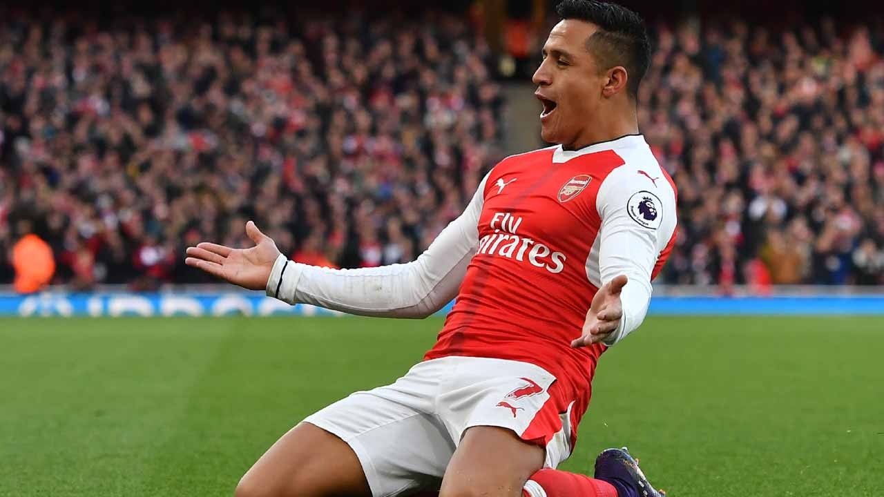 Arsenal's Chilean striker Alexis Sanchez celebrates after scoring the opening goal of the English Premier League football match between Arsenal and Bournemouth at the Emirates Stadium in London on November 27, 2016.  Ben STANSALL / AFP