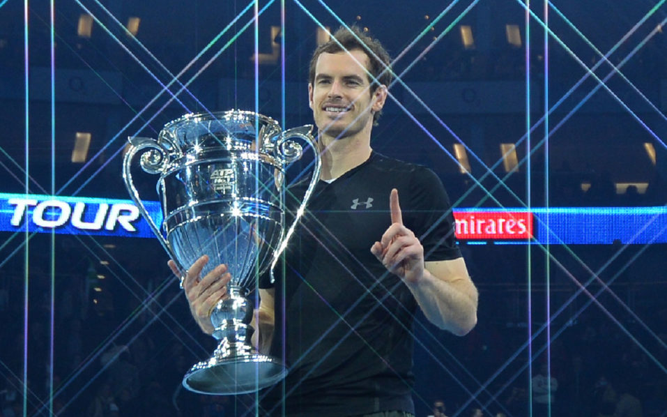 Britain's Andy Murray poses holding the ATP World Number One trophy after winning the men's singles final against Serbia's Novak Djokovic on the eighth and final day of the ATP World Tour Finals tennis tournament in London on November 20, 2016. / AFP PHOTO / Glyn KIRK