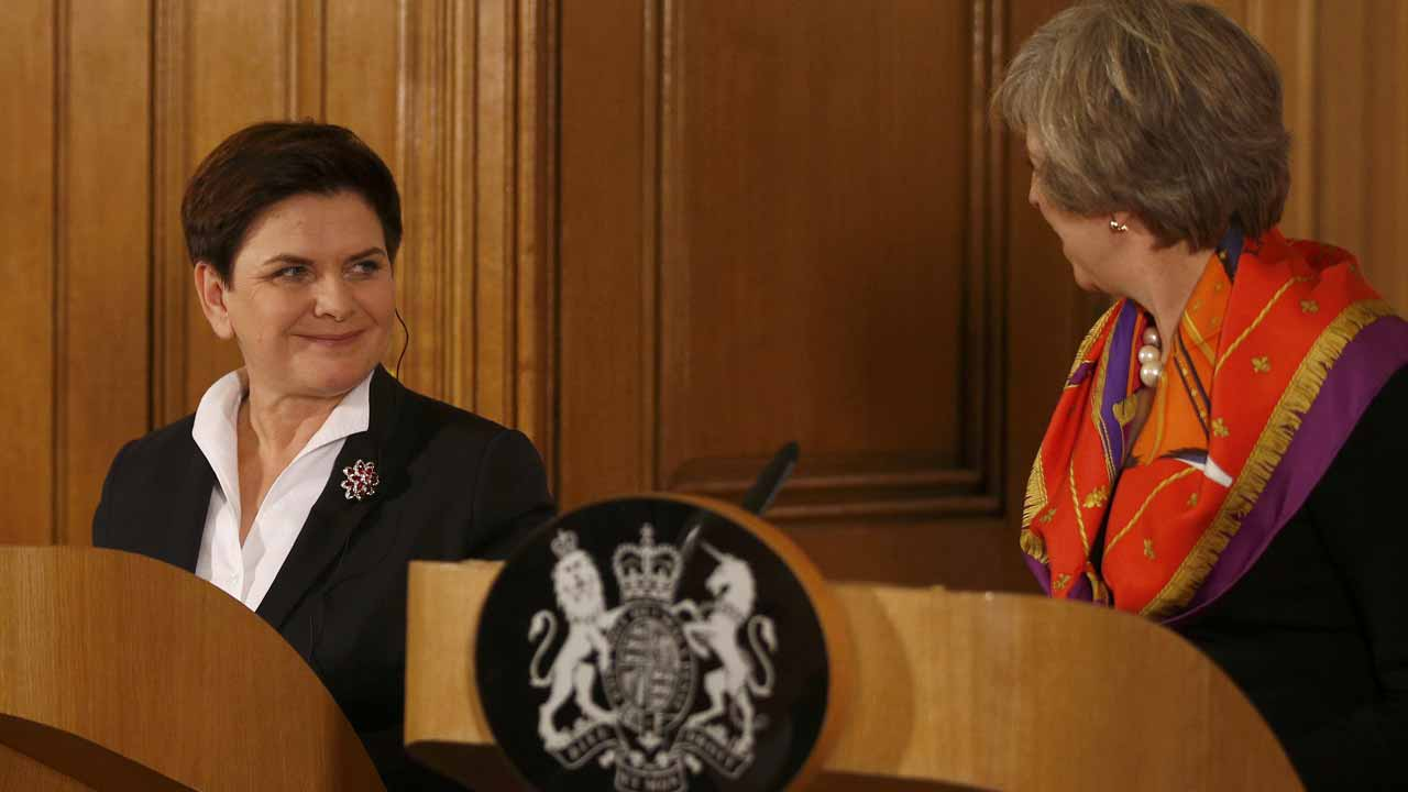 "British Prime Minister Theresa May (R) and Polish Prime Minister Beata Szydlo attend a joint press conference following their meeting at 10 Downing Street in central London on November 28, 2016. Poland's prime minister Szydlo called Monday for a Brexit ""compromise"" and said Europeans in Britain and Britons in Europe should not be ""made to feel like hostages"" as she kicked off a landmark trip to London. PETER NICHOLLS / POOL / AFP"