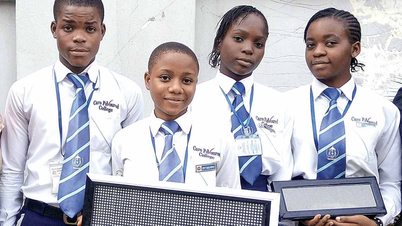 Winners of Junior Achievement Nigeria (JAN) National Company of the Year, Innovative Minds Company from Caro Favoured College, Ajegunle, Lagos State, display their product, programmable DOT Matrix LED display system, during a courtesy visit to Rutam House, the corporate headquarters of The Guardian.