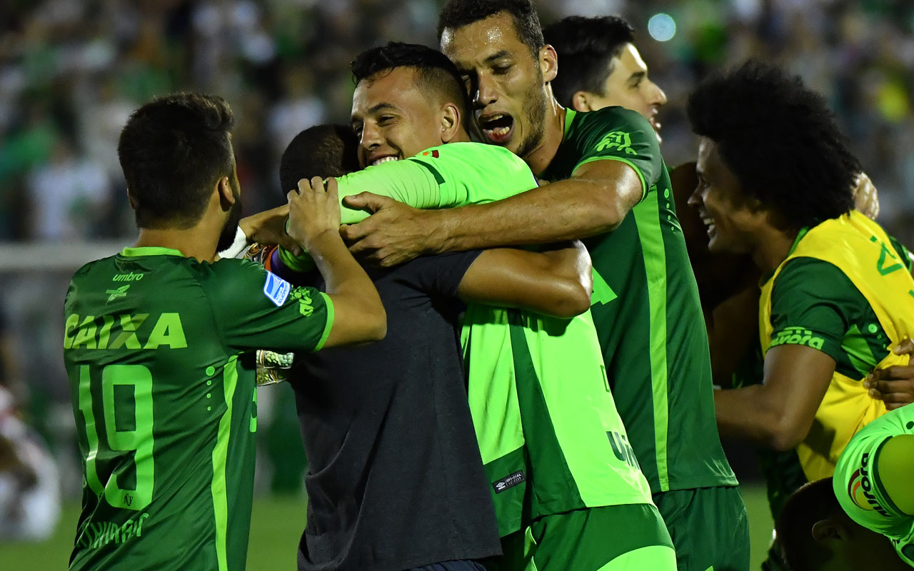 (FILES) This file photo taken on November 23, 2016 shows Brazil's Chapecoense goalkeeper Danilo celebrating after defeating Argentina's San Lorenzo during their 2016 Copa Sudamericana semifinal second leg football match held at Arena Conda stadium, in Chapeco, Brazil. A plane carrying 81 people, including members of a Brazilian football team, crashed late on November 28, 2016 near the Colombian city of Medellin, officials said. The survivors, two crew members and three players of Chapecoense Real Alan Ruschel, goalkeeper Danilo and Jackson Follman were transferred to local hospitals, according to radio Caracol. / AFP PHOTO / NELSON ALMEIDA
