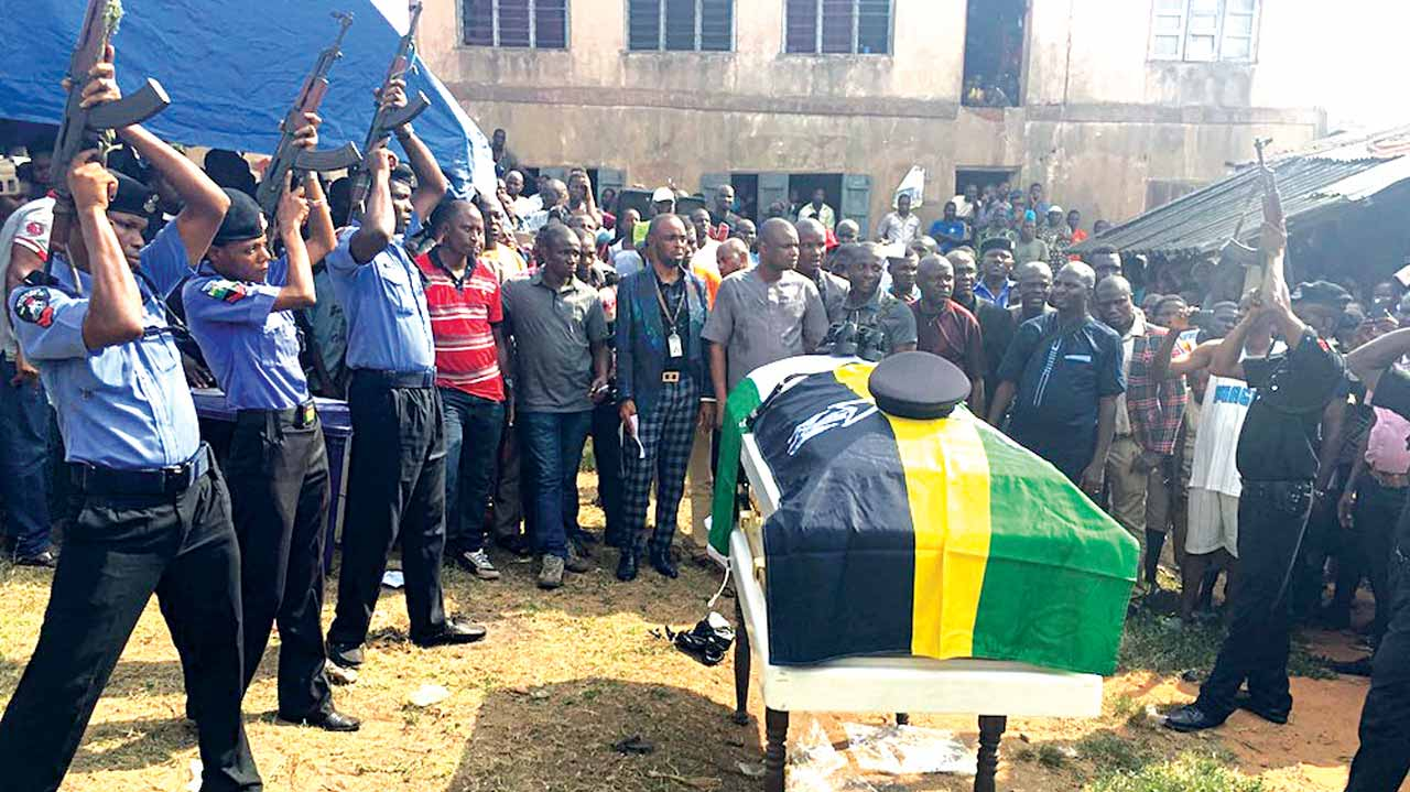 Gun salutes by some police officers during Igbasan's burial in Ondo